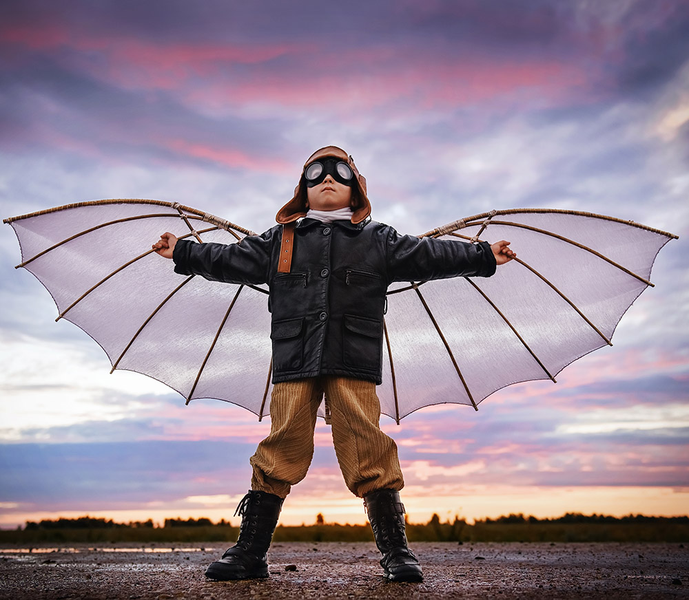 Boy with pilot outfit and fake wings