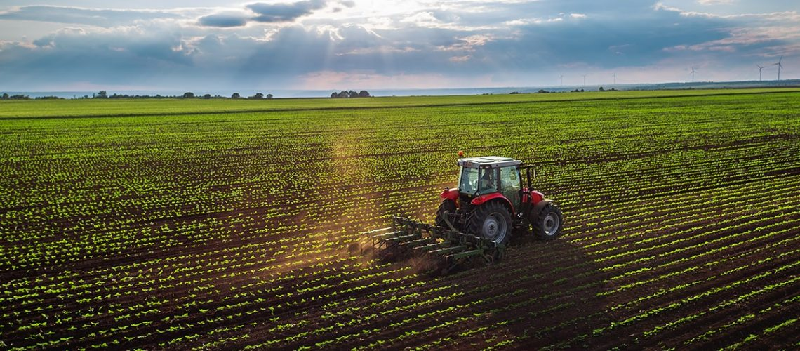 Tractor cultivating a field at Spring